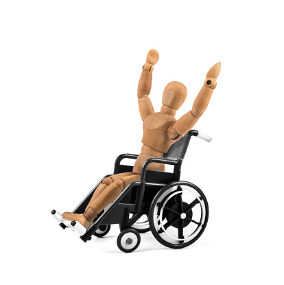 941792734 istock photo disabled wooden mannequin in wheelchair is happy - winnig? having fun? 941793018