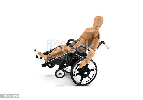 941792734istockphoto disabled wooden mannequin in wheelchair plays with balance 936809084