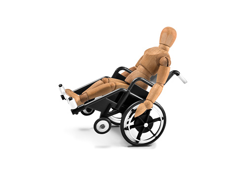 941792734 istock photo disabled wooden mannequin in wheelchair plays with balance 936809084