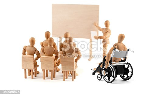 941792734istockphoto disabled Wooden Mannequin in wheelchair talking to a group of people 939985578
