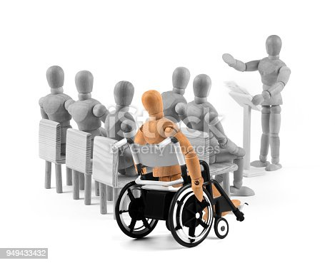 941792734istockphoto disabled Wooden Mannequin in wheelchair talking to a group of people 949433432