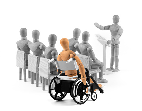 941792734 istock photo disabled Wooden Mannequin in wheelchair talking to a group of people 949433432