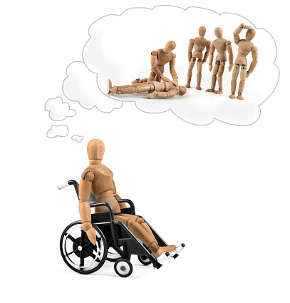 941792734 istock photo Disabled wooden mannequin in wheelchair thinking about cause, problems or future 939211930