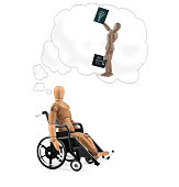 Disabled wooden mannequin in wheelchair thinking about cause, problems or future