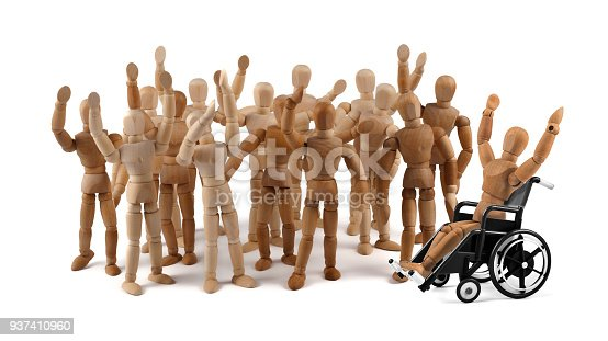941792734istockphoto disabled wooden mannequin in wheelchair together with friends in a crowd 937410960