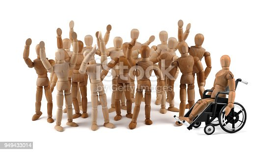 941792734istockphoto disabled wooden mannequin in wheelchair together with friends in a crowd 949433014