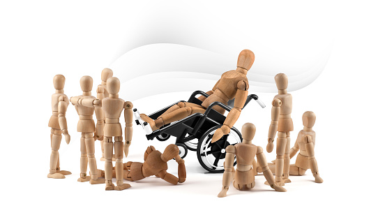 941792734 istock photo disabled wooden mannequin shows balance skills to children - integration 1218600578