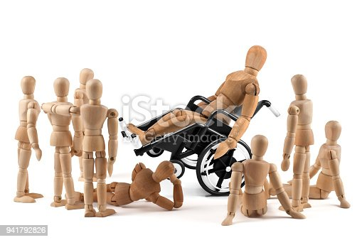 941792734istockphoto disabled wooden mannequin shows balance skills to children - integration 941792826