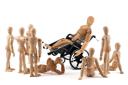 941792734 istock photo disabled wooden mannequin shows balance skills to children - integration 941792826