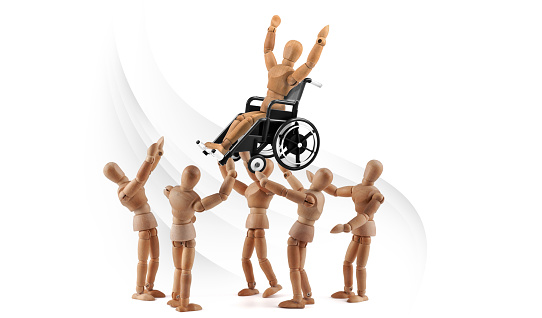 941792734 istock photo disabled wooden mannequin shows balance skills to friends - integration 1218600607