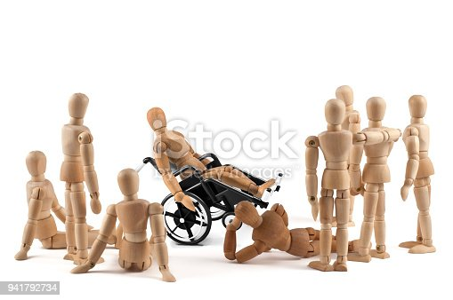 istock disabled wooden mannequin shows balance skills to friends - integration 941792734