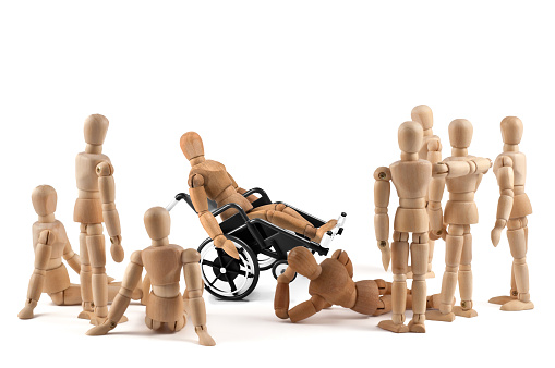 941792734 istock photo disabled wooden mannequin shows balance skills to friends - integration 941792734