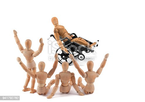 istock disabled wooden mannequin shows balance skills to friends - integration 941792782