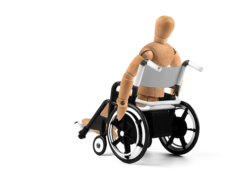 941792734 istock photo disabled wooden mannequin sitting in wheelchair 941793402
