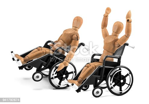 941792734istockphoto disabled wooden mannequins in wheelchair are happy - winnig? having fun? 941792674
