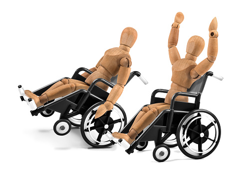 941792734 istock photo disabled wooden mannequins in wheelchair are happy - winnig? having fun? 941792674
