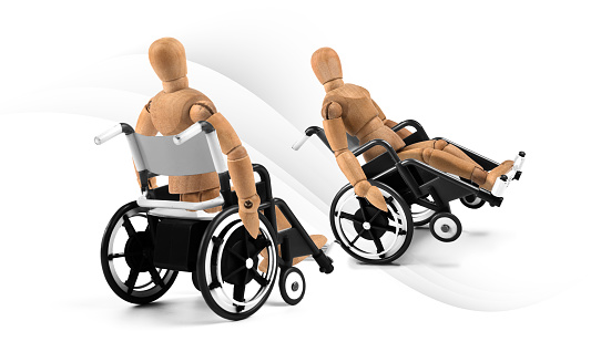 941792734 istock photo disabled wooden mannequins in wheelchair talking together 1218600650