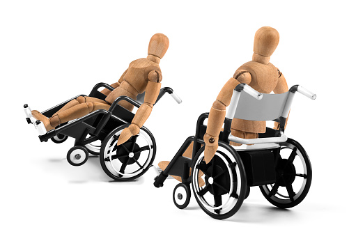 941792734 istock photo disabled wooden mannequins in wheelchair talking together 941793342