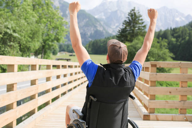Disabled young man on a wheelchair stock photo