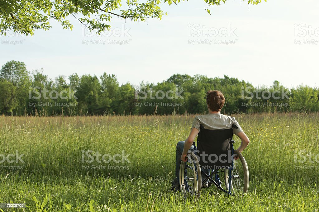 Disabled young man on the park royalty-free stock photo