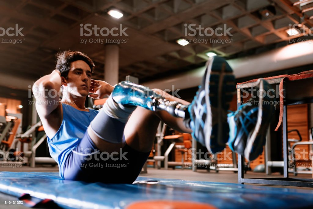 Disabled young man training in the gym stock photo