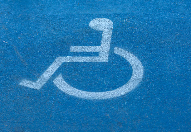 disabled,handicap sign on blue floor stock photo