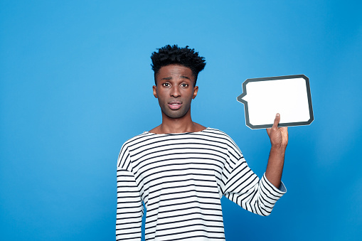 Disappointed Afro American Guy Holding Speech Bubble Stock Photo - Download Image Now