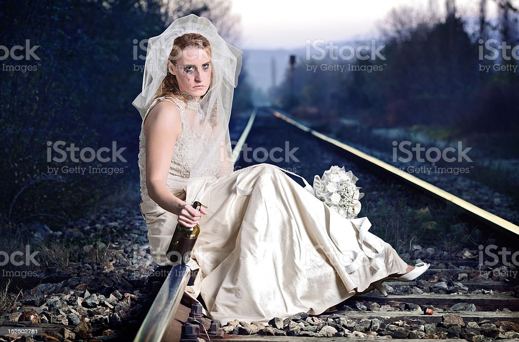Disappointed bride on a railway royalty-free stock photo