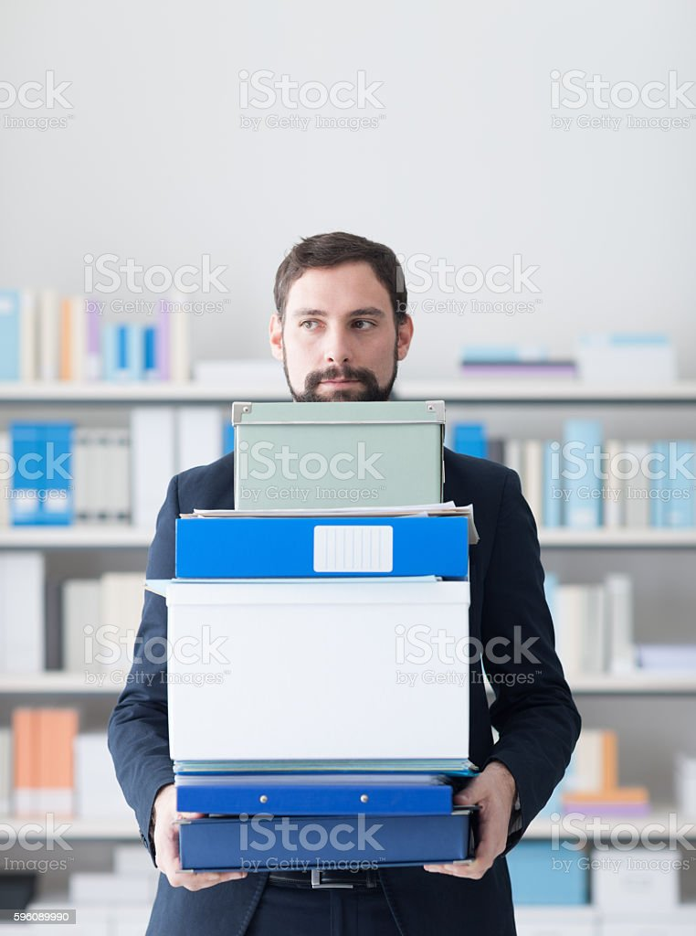 Disappointed businessman carrying boxes royalty-free stock photo