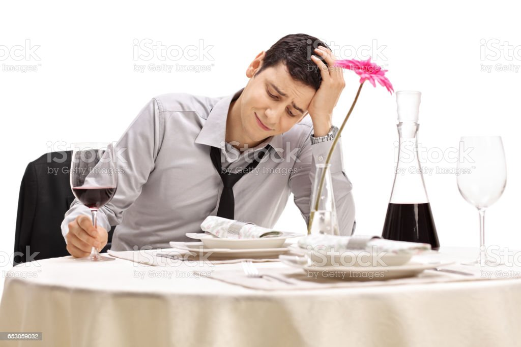 Disappointed businessman holding his head in disbelief stock photo