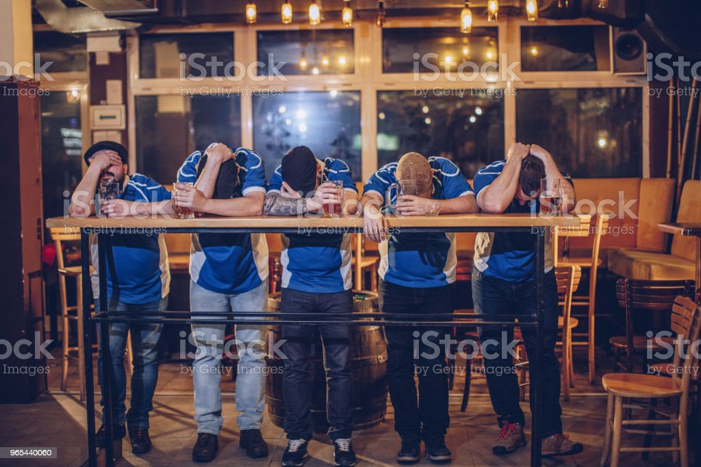 Disappointed fans in pub royalty-free stock photo