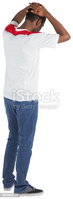 istock Disappointed football fan looking down 834904038