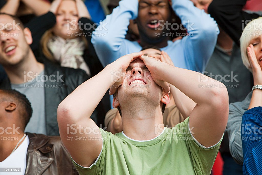Disappointed football fan stock photo