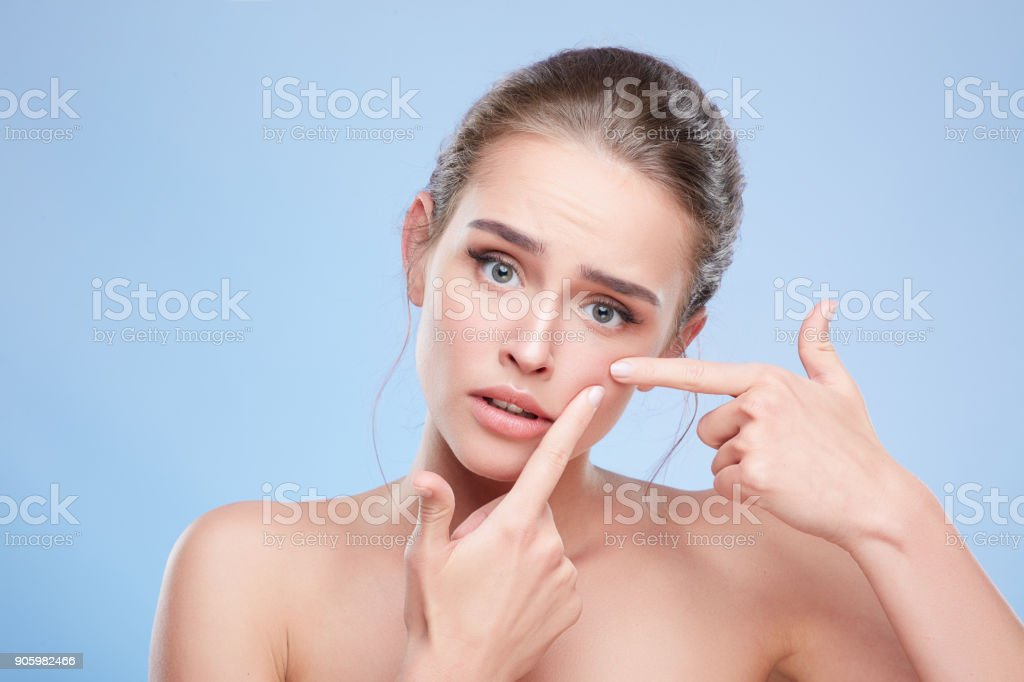 Disappointed girl looking at camera - foto stock