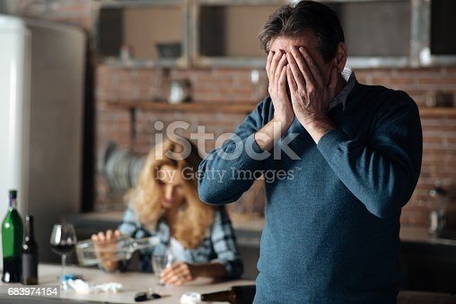 istock Disappointed male person covering his face 683974154