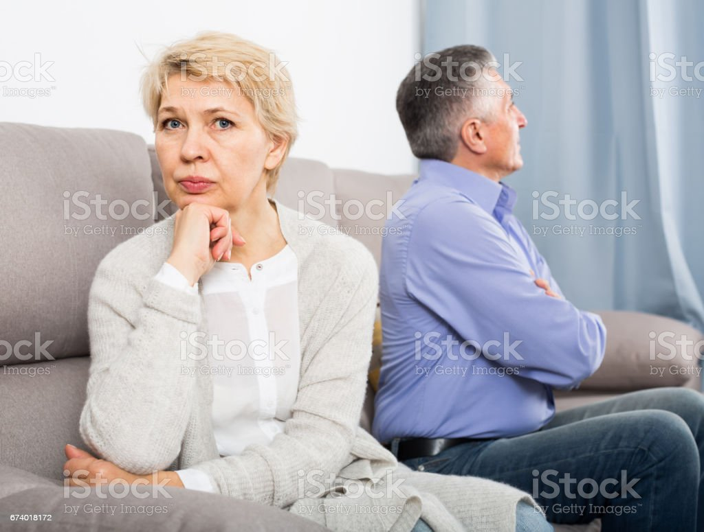 disappointed middle-aged couple quarreling at home with each other royalty-free stock photo