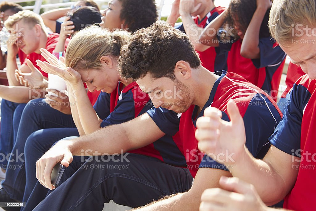 Disappointed Spectators In Team Colors Watching Sports Event stock photo