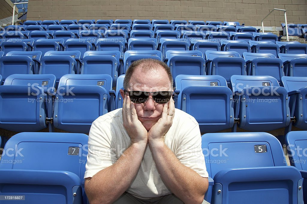 disappointed sports fan royalty-free stock photo