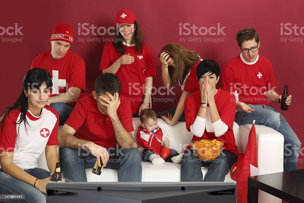 Disappointed Swiss sports fans royalty-free stock photo
