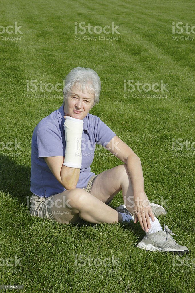 Disappointed Woman with Broken Arm royalty-free stock photo