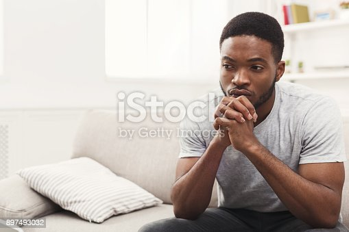 istock Disappointed young african-american man at home 897493032