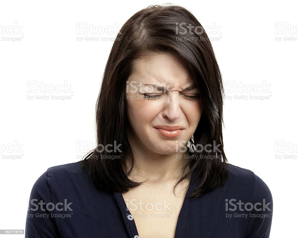 Disappointed Young Woman Frowns and Closes Eyes stock photo