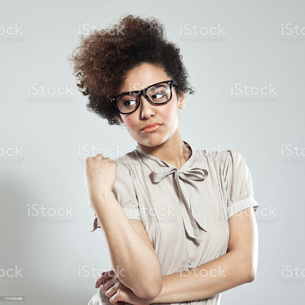 Disappoitment Portrait of teenaged afro girl wearing nerd glasses and looking away. Studio shot, grey background. 18-19 Years Stock Photo