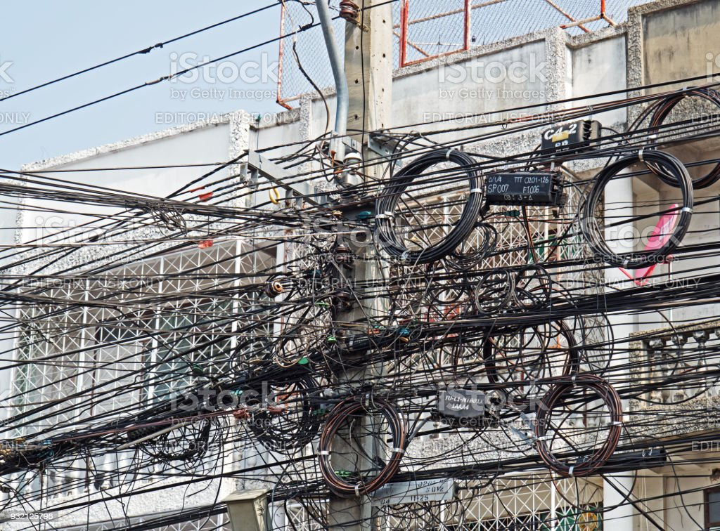 Wondrous Disarrangement Of Electric Wire On Pole Near Building Stock Photo Wiring Cloud Hisonuggs Outletorg