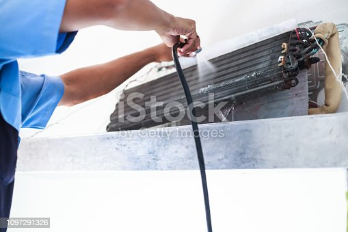 istock Disassemble and Clean Air Conditioner  Parts by high pressure water or air from nozzle or vacuum. Device Maintenance, Health Care, Germ Proactive Prevention, In House Cleanliness and Hygiene concept. 1097291326