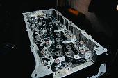 istock disassembled car engine repair, valve adjustment 1205033750