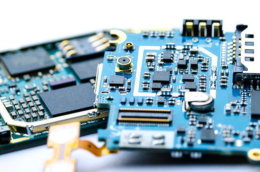 Disassembled Electronic Boards With Chips Electronic Components And Precious Metals For Recycling Stock Photo - Download Image Now