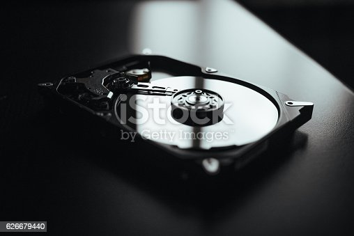 istock Disassembled hard drive from the computer, hdd with mirror effect. 626679440