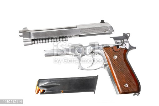 Disassembled gun isolated on white background