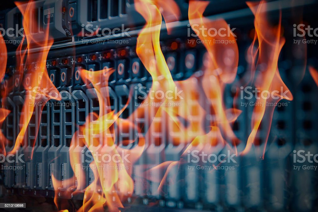 Disaster data center room server and storage on fire burning stock photo